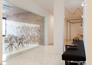 Barcelona / Spain - February 2020:  Corridor with black sofa. Luxury waiting room. White chairs and glass wall.